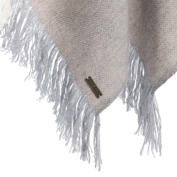 Hanging fringe detail of folded scarf in neutral tones of cream, beige and soft blue in cashmere and wool handwoven finished with fringe from Thread Tales company