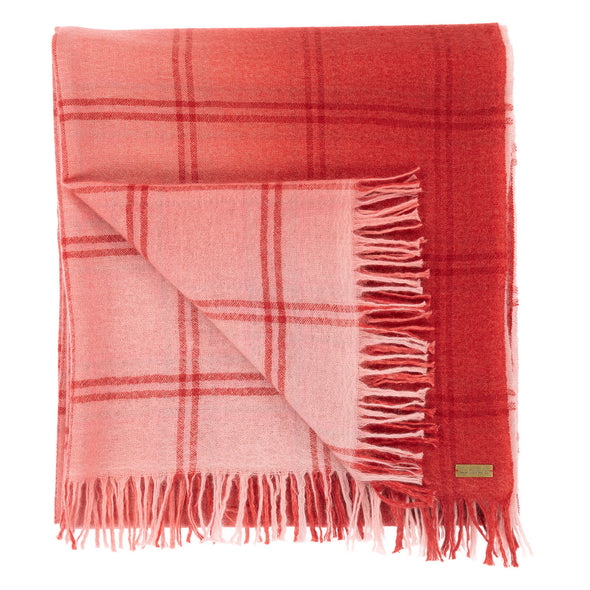 Folded detail of scarf blush pink woven with subtle open check in darker shade then dip dyed in shades of red to subtle effect. Made from wool and cashmere lightweight warm luxurious scarf from Thread Tales company