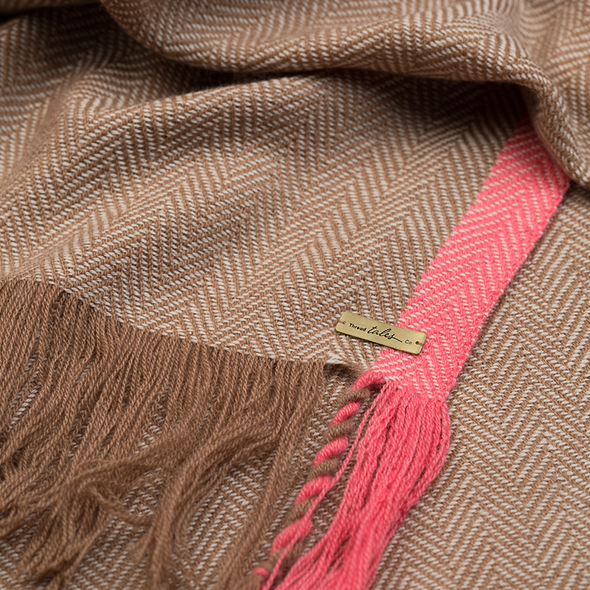 Folded detail of scarf showing twisted yarn fringe camel beige blended with cream scarf with light pink stripe 2cm wide down both edges. As featured in The Sunday Times luxurious scarf from Thread Tales company