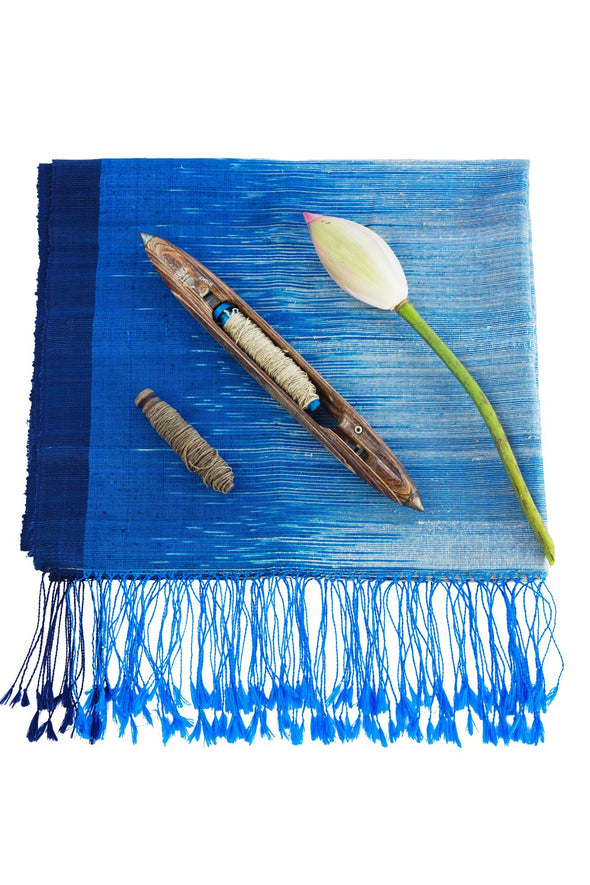 Folded detail Ikat blanket shawl fringe blue light to dark azure shades lotus mandalay silk fabric handwoven to order from Thread Tales company