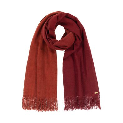 Neckloop of scarf which has been dip dyed in subtle shades of rust to dark red crimson. Made from wool, yak and cashmere, a soft and luxurious scarf from Thread Tales company