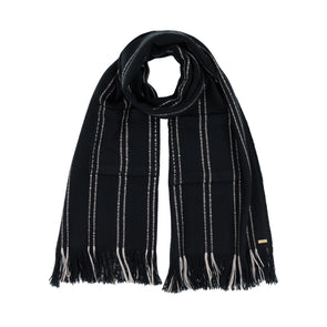 Model wearing blanket scarf wrap Mulesing-free Merino wool detailed section cream with black stripe broken stripe long fringe monochrome hand woven from Thread Tales company