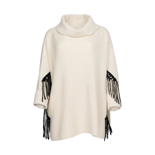 Front view of one size poncho loose-fitting wrap with sleeves knitted in cream 50% cashmere/wool mix edged with a hand-embroidered geometric design in charcoal grey black with trailing threads along edge of body and sleeves from Thread Tales company