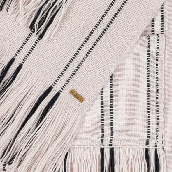 Blanket scarf wrap folded pocket detail section cream with black stripe broken stripe long fringe monochrome hand woven from Thread Tales company
