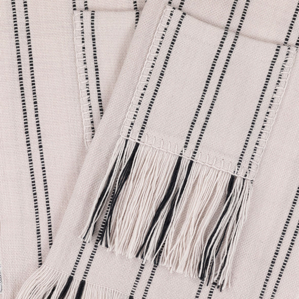 Blanket scarf wrap folded display pocket cream with black stripe broken stripe long fringe monochrome hand woven from Thread Tales company