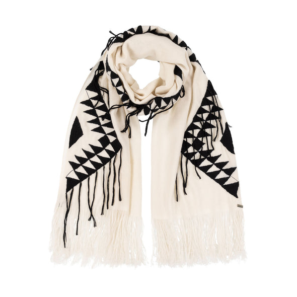 Folded neckloop of large scarf wrap knitted in cream 50% cashmere and wool edged with a hand-embroidered geometric design in charcoal grey black with trailing threads along edge of pattern and long cream fringe from Thread Tales company