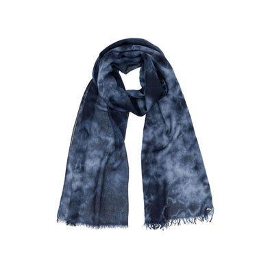 Model wearing navy indigo hand tie dyed scarf made from 100% certified cashmere by Thread Tales company