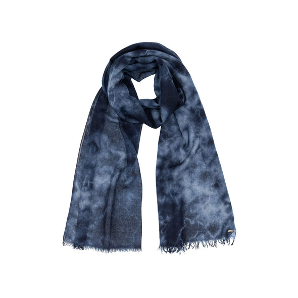 Folded neckloop of navy indigo hand tie dyed scarf made from 100% certified cashmere by Thread Tales company