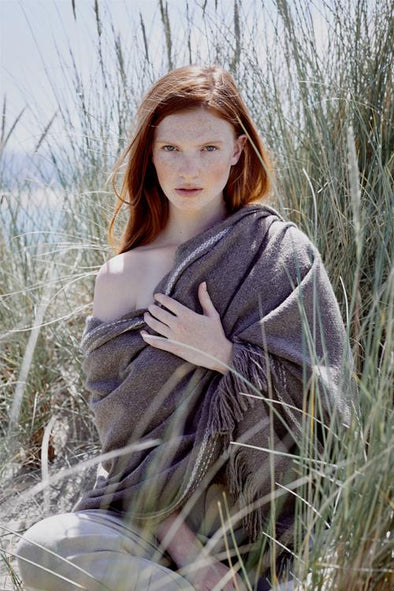 Model wearing brown blanket shawl scarf large yak soft luxurious edge stripe cream from Thread Tales company