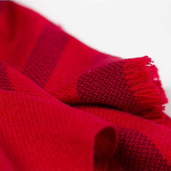 Side detail fringed travel wrap red with crimson striped edge fringed cashmere wool from Thread Tales company