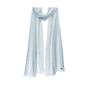 Model draped image of sustainable linen scarf showing striped blue denim scarf from Thread Tales