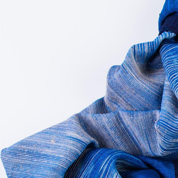 Folded detail Ikat blanket shawl blue light to dark azure shades lotus mandalay silk fabric handwoven to order from Thread Tales company