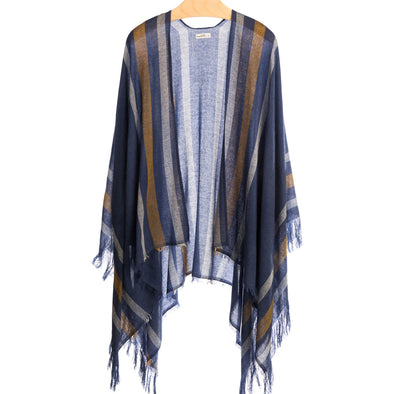 Model wearing fringed travel wrap navy with tan and cream striped edge fringed cashmere wool from Thread Tales company