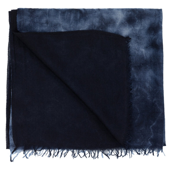 Folded detail of navy indigo hand tie dyed scarf made from 100% certified cashmere by Thread Tales company