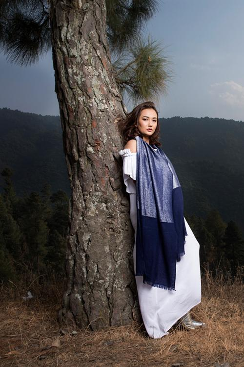 Model wearing long scarf in navy soft cashmere mix with metallic lighter navy blue yarn from Thread Tales company