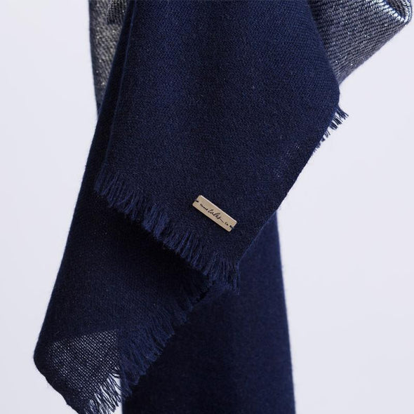Hanging detail of scarf in navy soft cashmere mix with metallic lighter navy blue yarn from Thread Tales company