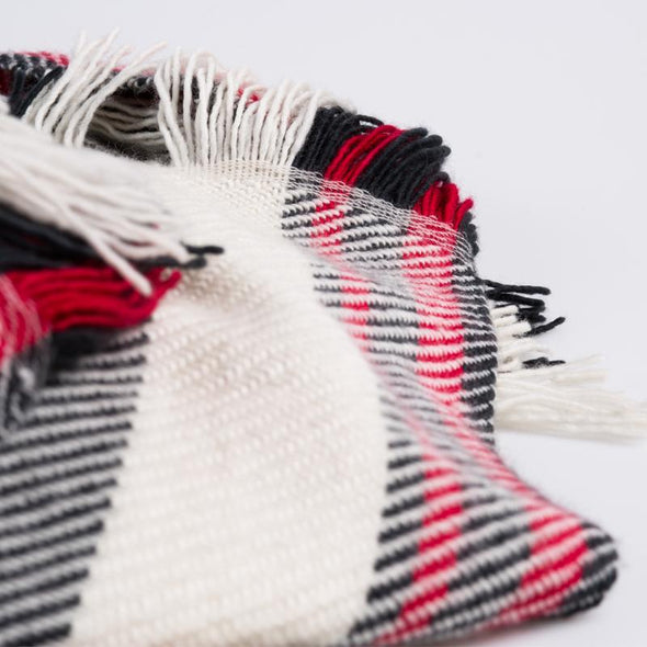 Scarf detail section fringe with red, black white twill stripes merino wool, handwoven heavyweight blanket from Thread Tales company