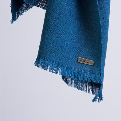 Lotus silk scarf in teal showing draped corner detail