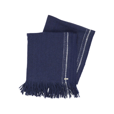 Model wearing navy indigo blanket shawl scarf large yak soft luxurious edge stripe cream from Thread Tales company