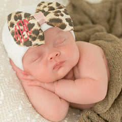 Monogrammed Leopard Bow Baby Newborn Girl Hospital Hat - White Hat with Leopard Fabric Bow icon