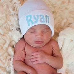 White Personalized Newborn BOY hospital baby hat with BABY Blue Lettering icon