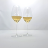 Cour Des Lys engraved Riedel champagne glasses with champagne