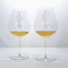 Cour Des Lys empty Riedel Veritas champagne glasses with champagne