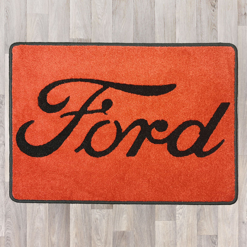 Rectangle floor rug shown in red with black trim and ford logo