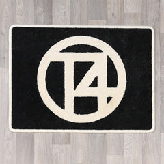 Rectangular rug with T4 logo in black and cream colours