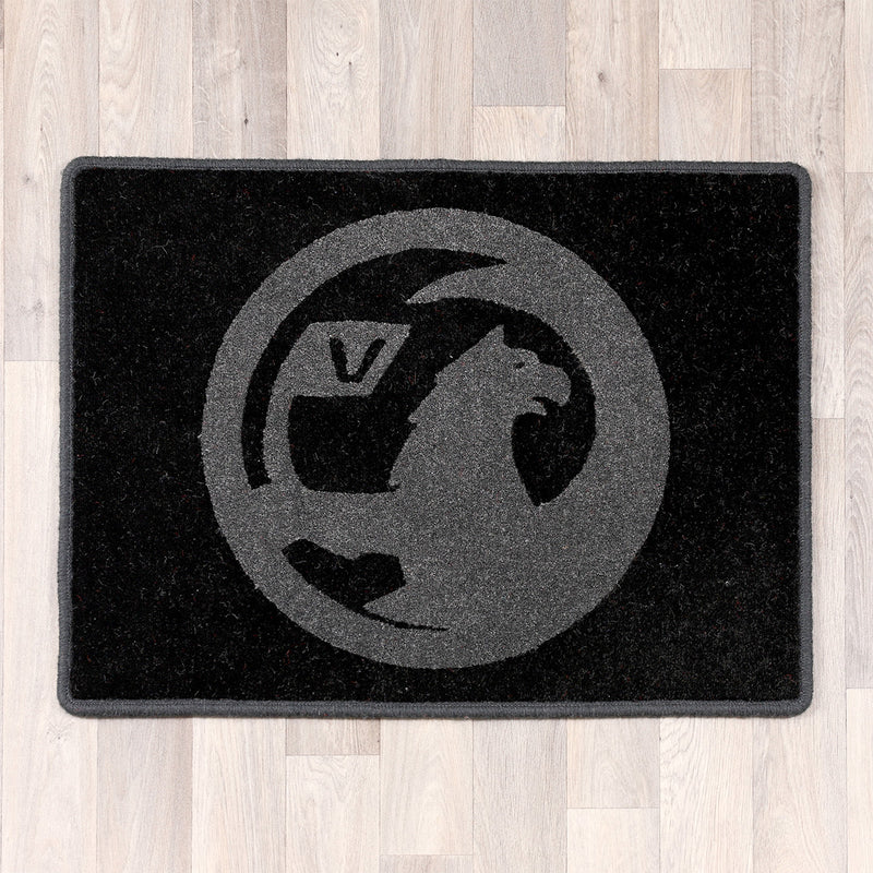 Rectangular rug with Vauxhall logo in light and dark grey colours