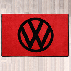 VW rectangle floor rug 100cm by 80cm shown in red with black logo and trim