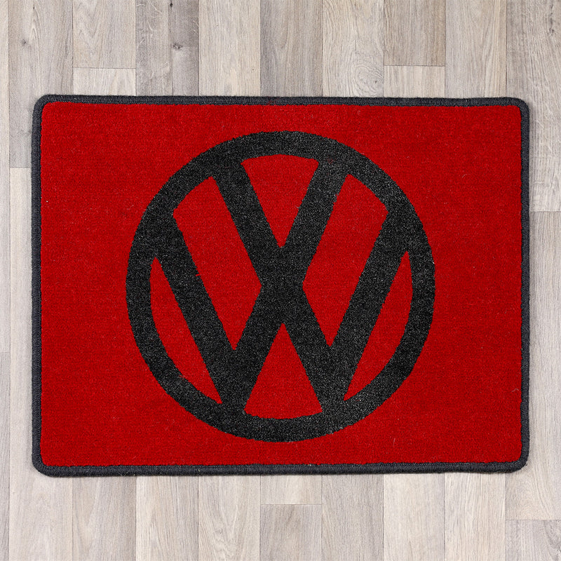 rectangular rug with vw logo in red and black
