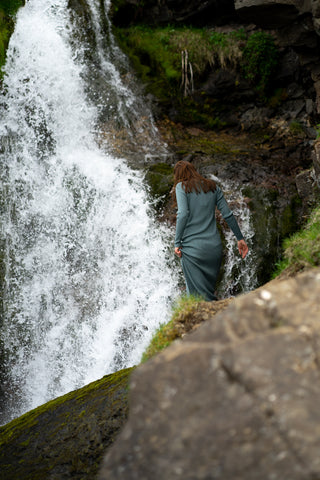 Soley model walking by waterfall in Iceland