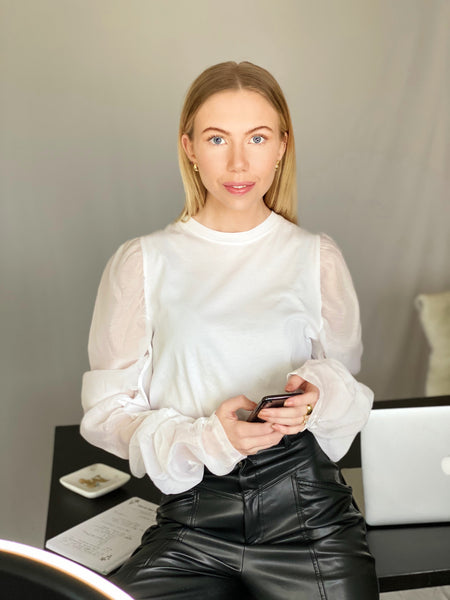 Mira Treece wearing Sheer puff sleeve top from The Dallant