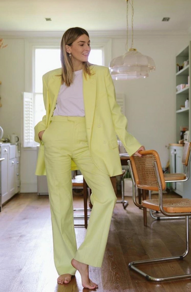 @camillecharriere wearing a yellow suit
