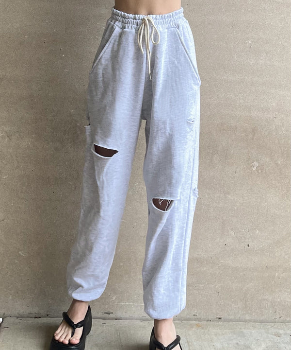 Oversized cutout distressed sweatpants