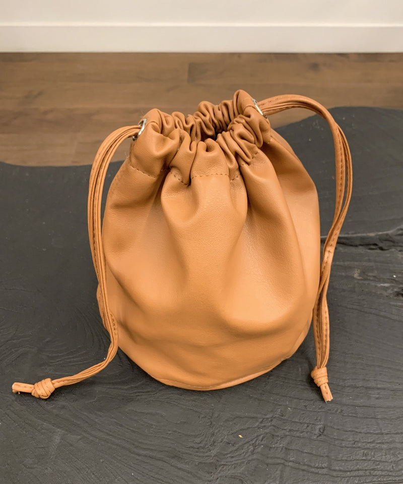 Vegan leather drawstring bucket pouch bag in camel - The Dallant