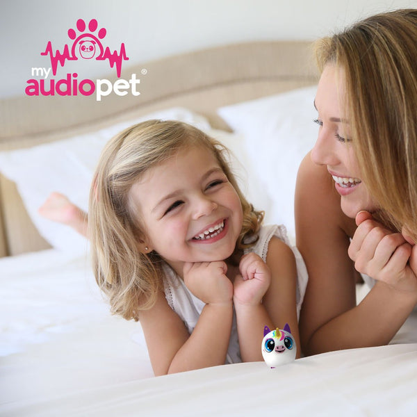 My Audio Pet UniChord Wireless Bluetooth Speaker with True Wireless Stereo Magical Unicorn giving music to mom and daughter hanging out on the end of the bed smiling and giggling