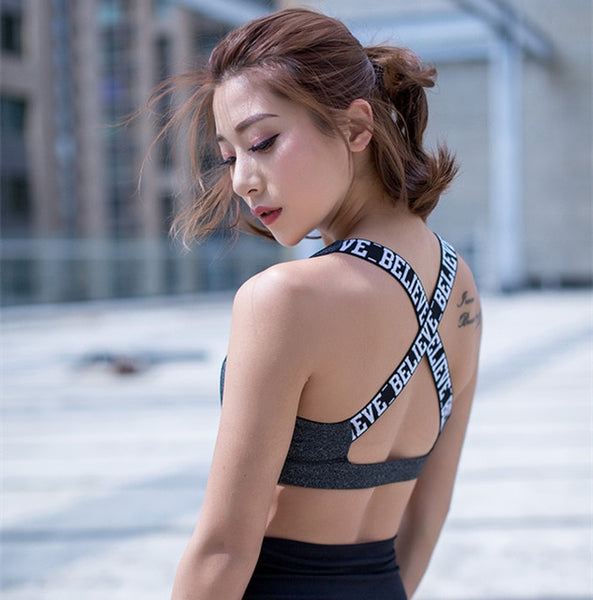 + Scripted crossed-back sports bra +