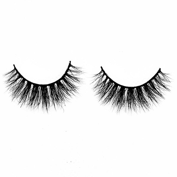 "Jasmine-Medium Volume-Our 3D Mink Lashes in style ""Jasmine"" are a MUST HAVE. Grab a pair of ""Jasmine"" lashes to achieve a subtle, but ""flirty"" look. Whether it's date night or a day out with the girls, these lashes are a staple to your beauty collection. They give you the perfect volume and suite most eye shapes. The longer hairs in the center create a beautiful effect to help bring out your eyes more. Also available in our ""Best Sellers (3-Pack)"" Description: Handmade, Cruelty-Free, Wear up to"
