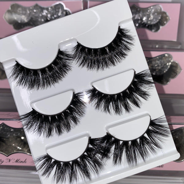 Boss Up (3-Pack)-High Volume-This set includes (3) High Volume Mink lashes: Hustla Finesser Indespoiled Description Handmade, Cruelty-Free, Wear up to 30x Material: 100% Mink Band: Black Cotton Band Volume: High Volume Style: Dramatic, Long, Wispy, Cat-eye, Open-eye To Use: Measure and size your lashes by placing the false lash against your lash line where your natural lashes start. Using Mini Scissors, cut off the excess lash band length from the outer corners to ensure they fit properly. Apply
