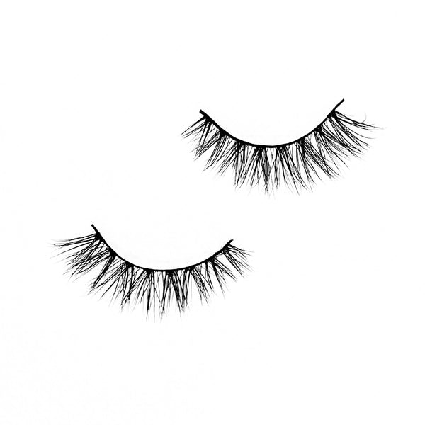 "Butterfly-Medium Volume-""Butterfly"" is a natural yet unique 3D lash that's perfect for everyday looks. Our light volume ""Butterfly"" lashes add the finishing touch to any everyday, on the go, natural look. The unique design and cat-eye effect from these lashes will have you hooked! Description Handmade, Cruelty-Free, Wear up to 30x Material: 100% Mink Band: Black Cotton Band Volume: Medium Style: Wispy, Cat-eye, Flirty, Natural To Use: Measure and size your lashes by placing the false lash agains"