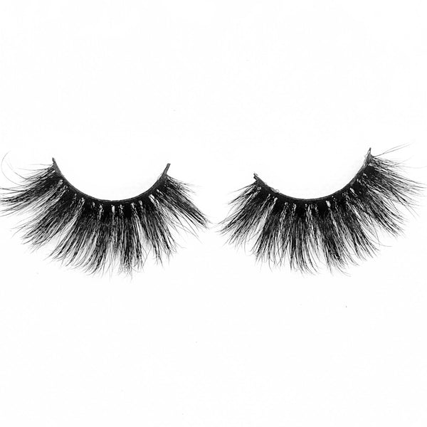 "Conceited-Mega Volume-Extra long 25mm lashes for an extra girl. ""Conceited"" is extra fluffy, extra wispy, and extra dramatic. You're guaranteed to catch everyone's attention in these gorgeous lashes. After all, why be basic? Also available in our ""Pretty Gal (3-Pack)"" Description Handmade, Cruelty-Free, Wear up to 30x Material: 100% Mink Band: Black Cotton Band Volume: Mega Volume Style: Wispy, X-Long, Dramatic, Open-eye, Flirty To Use: Measure and size your lashes by placing the false lash agai"