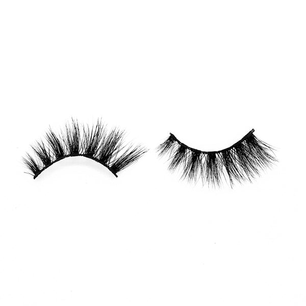 "Honey-Medium Volume-""Honey"" is a chic, wispy, 5D lash perfect for anyone. Whether this is an everyday look, or you're going out, your look will always be complete in this medium volume style. They add an instant touch to you look without being too dramatic or heavy on the eyes. Also available in our ""Wispy (3-Pack)"" Description Handmade, Cruelty-Free, Wear up to 30x Material: 100% Mink Band: Black Cotton Band Volume: Medium Style: Wispy, Cat-eye, Flirty, Natural To Use: Measure and size your las"