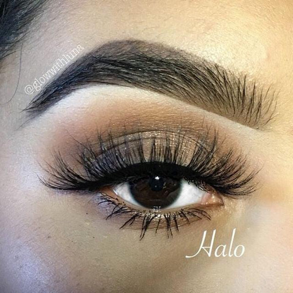 "Halo-High Volume-You'll feel unbelievably confident in our mink lash style ""Halo."" These long, wispy lashes are perfect for a glamorous look. The longest hairs are located in the middle, creating a gorgeous eye opening effect that'll make the whole world stop and stare! They're super versatile and pair perfectly with a seductive, smokey eye look. Also available in our ""Dramatic (3-Pack)"" Description Handmade, Cruelty-Free, Wear up to 30x Material: 100% Mink Band: Thin, Black Cotton Band Volume:"