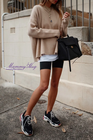 girl in shorts and cashmere pullover