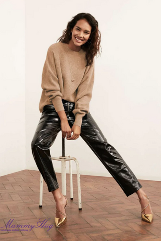 The combination of a cashmere sweater and leather pants in a women's outfit