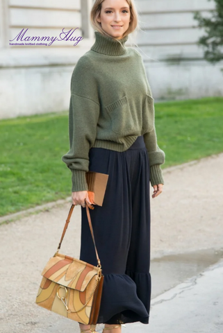 woman in green knitted sweater and black skirt