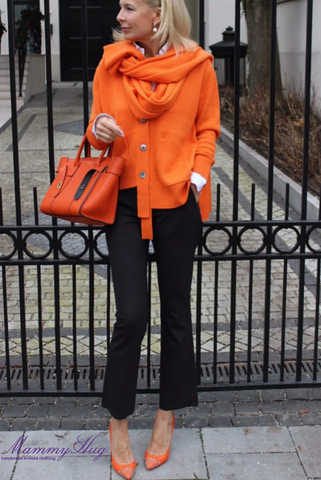 Business lady in orange cashmere sweater