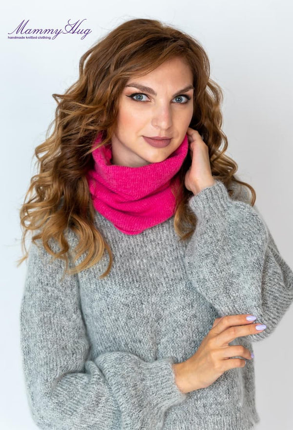 Woman in cashmere sweater and pink snood